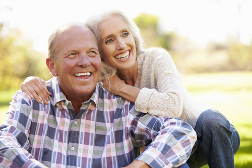 Elderly couple smiling for a picture.